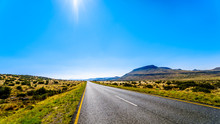 Long Straight Road Through The Endless Wide Open Landscape Of The Semi Desert Karoo Region In Free State And Eastern Cape Provinces In South Africa Under Blue Sky