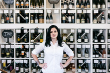 Wine: Knowledgable Owner In Front Of Wine Wall