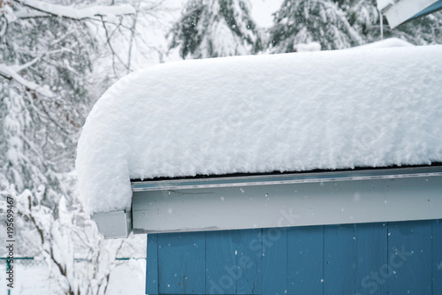 thick snow accumulated on top of the roof Canvas Print