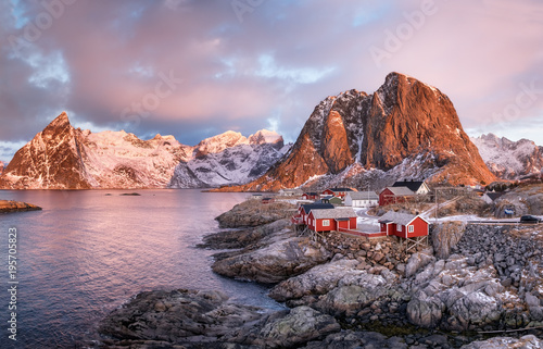 Recess Fitting Pole Houses in the Lofoten islands bay. Natural landscape during sunrise