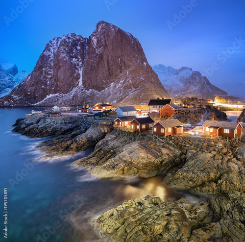 Fotobehang Poolcirkel Houses in the Lofoten islands bay. Natural landscape during sunrise