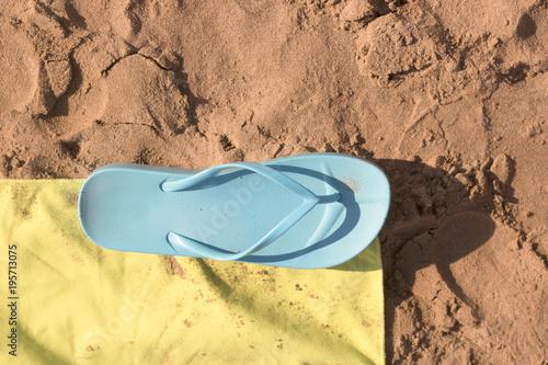 Flip flops on the sand of the beach