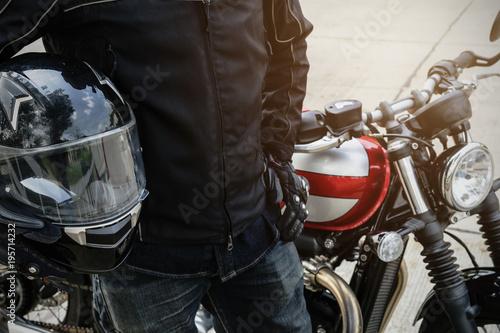 Fotografia, Obraz Biker wear jacket suit hold helmet with retro motorcycle