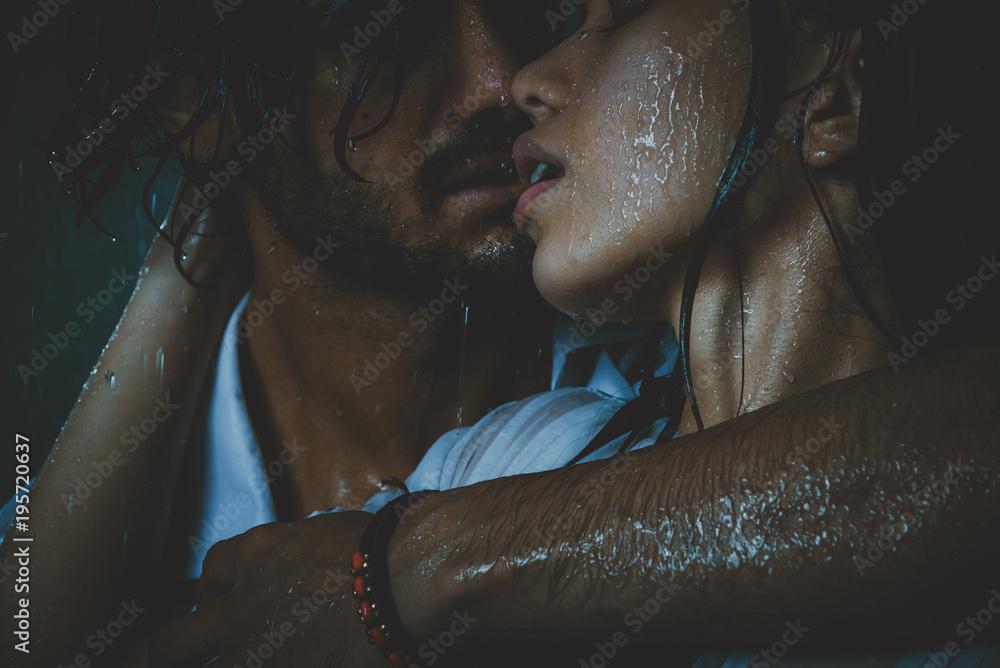 Fototapeta Couple sharing romantic moments under the rain