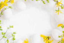 Spring Easter Background With White Eggs Forsythia Flowers