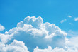 White, fluffy, cumulus clouds against the blue sky, texture