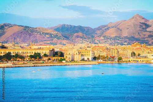 Sunrise at Mediterranian sea and Palermo old city