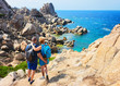 Couple looking at Sea and rocks in Capo Testa
