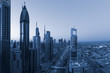 Dubai downtown skyline at beautiful blue sunrise
