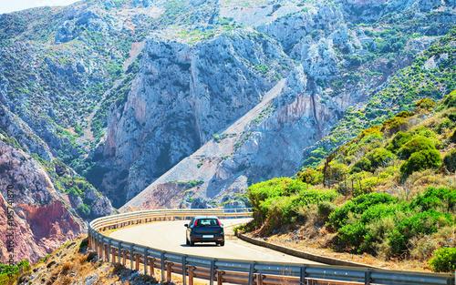Photo  Car on road at Buggerru in Carbonia Iglesias Sardinia