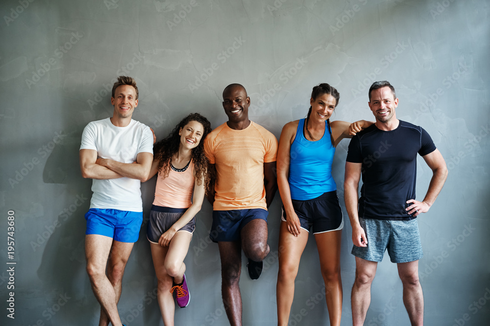 Fototapety, obrazy: Laughing friends in sportswear standing together in a gym