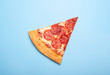canvas print picture - slice of delicious pizza pepperoni isolated on blue background
