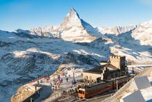 Skiers And Snowboarder Were Preparing To Ski At Gornergrat Bahn Train Station With Matterhorn Peak View At The Background Of Ski Track..