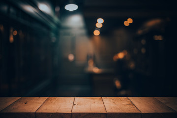 Wood table top on blurred o...