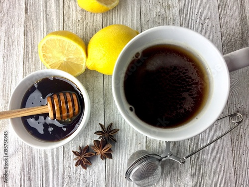 Tea Hot tea with honey and lemon on a rustic wood surface