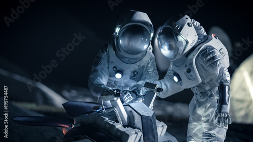 Photo Two Astronauts in Space Suits on an Alien Planet Prepare Space Rover for Planet's Surface Exploration Expedition