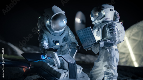 Two Astronauts in Space Suits on an Alien Planet Prepare Space Rover for Planet's Surface Exploration Expedition, Use Laptop Canvas Print