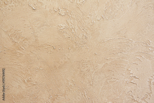 Poster Beautiful textured wall of beige color. Rough and rubbed
