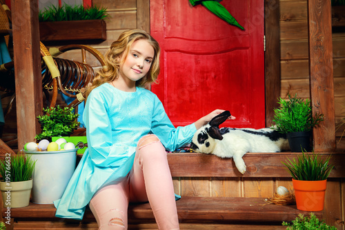pre-teen girl and rabbit