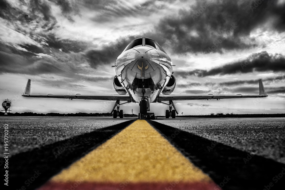 Fototapeta Colour key, high contrast black and white photo of a parked Business-Jet waiting for passengers.