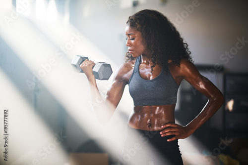 Fotografie, Obraz  fit african american woman lifting iron in home gym