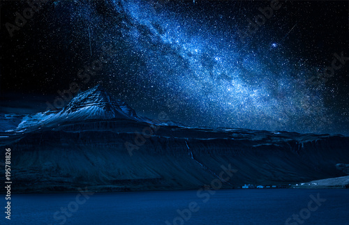 Poster de jardin Bleu nuit Milky way and volcanic mountain over fjord at night, Iceland