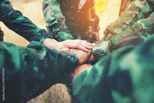 Teamwork Concept : Group of Soldier Hands Together Cross Processing ready to fight Canvas-taulu