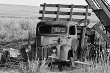 Old Abandoned Farm Truck In Field