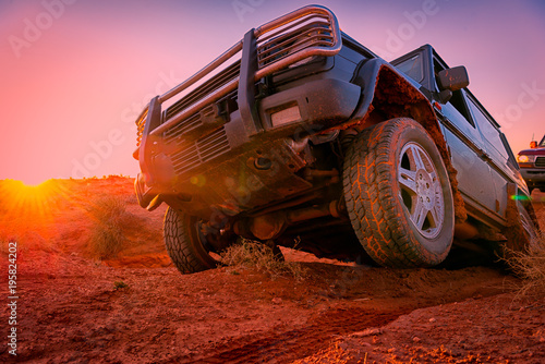 Fotobehang Motorsport Through the desert in a 4x4 vehicle