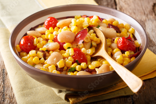 organic salad succotash from the butter beans, tomatoes and bacon close up in a bowl. horizontal
