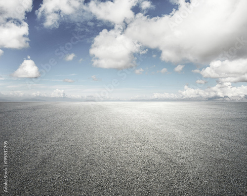 Empty road with cloudy sky background Wall mural