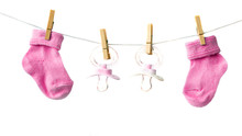 Baby Socks And Pacifiers On Th...
