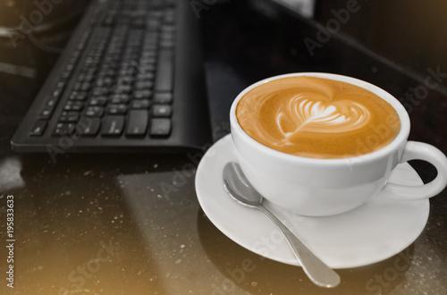 Top View Of Hot Coffee Cuccino Latte Art In White Ceramic
