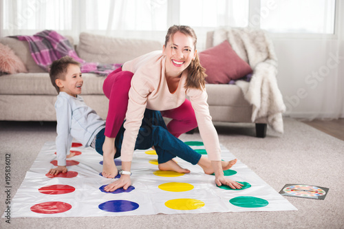 Fotografie, Obraz  Young loving mother having fun with her child indoors