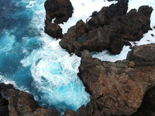 Aerial Top View Of Sea Waves Hitting Rocks On Tenerife, Canary Islands