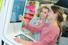2 Women Using An Interactive K...
