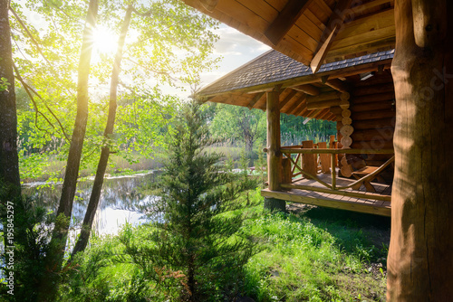 Wooden house and river Canvas Print