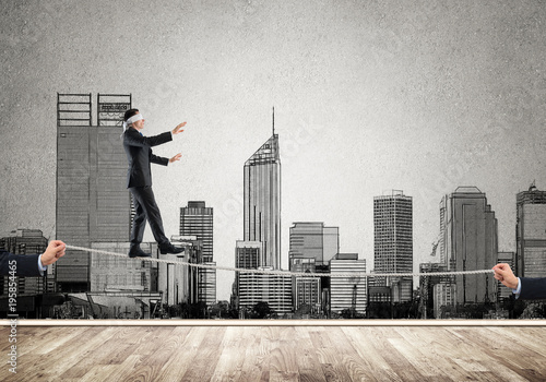 Poster New York Business concept of risk support and assistance with man balancing on rope
