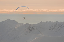Man Flying On The Parachute In...