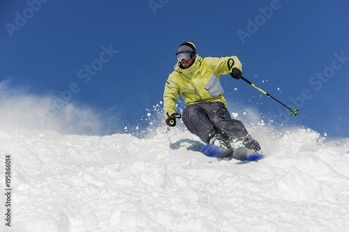 Montage in der Fensternische Wintersport Bearded skier running down the mountain slope in resort of Gudauri, Georgia
