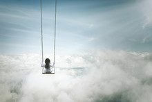 Lonely Girl Sitting On The Swing Above Clouds