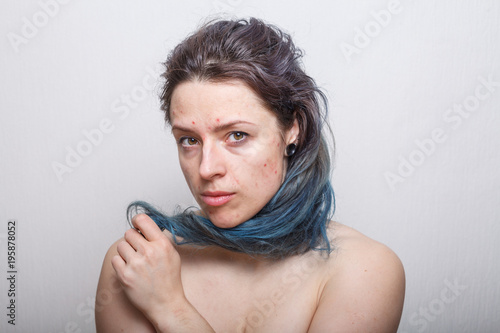 Young woman rolling her colorful damaged messy hair on her finger Canvas Print