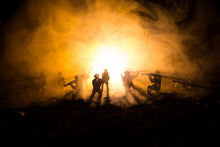 War Concept. Military Silhouettes Fighting Scene On War Fog Sky Background, World War Soldiers Silhouettes Below Cloudy Skyline At Night. Attack Scene. Armored Vehicles. Tanks Battle.