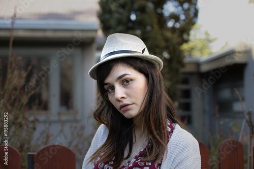 Portrait of a young woman with hat; close up, selective focus background Fototapeta