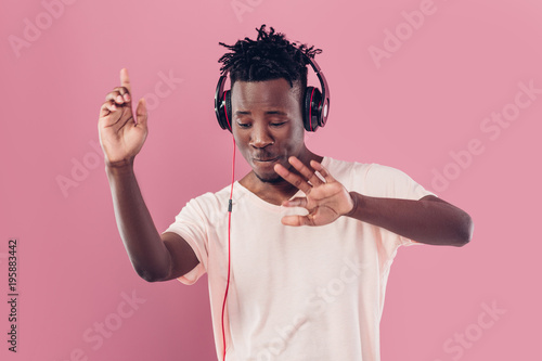 African-American man in headphones listening to music - 195883442