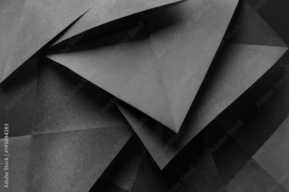 Fototapeta Geometric shapes of gray paper for dark abstract background
