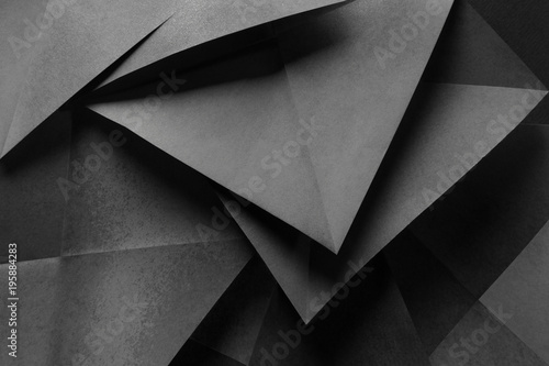 Geometric shapes of gray paper for dark abstract background