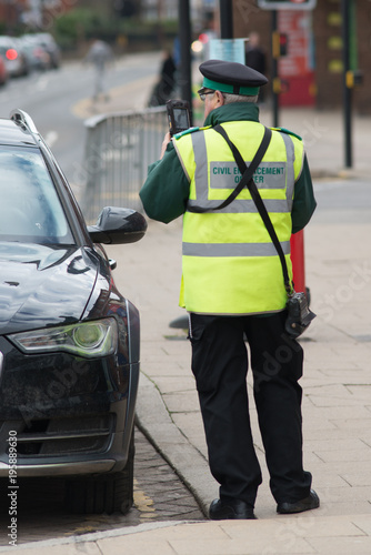 Wallpaper Mural civil enforcement officer traffic warden issuing ticket to car parked incorrectl
