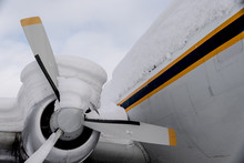 Close-up Of Snow-covered DC-4 Aircraft Propeller And Engine