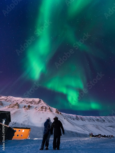 The polar arctic Northern lights aurora borealis sky star in Norway Svalbard in Poster